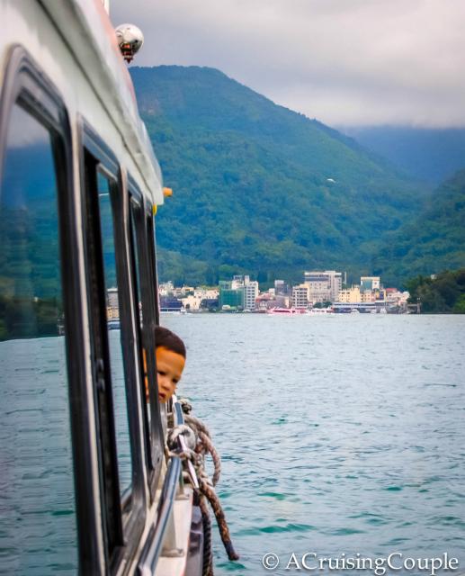 Boy On A Boat Sun Moon Lake